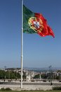 Portuguese flag flying on highpoint with views of lisbon city Royalty Free Stock Photos