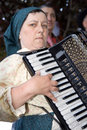 Portuguese folklore accordionist old lady playing the accordion with traditional costumes on popular culture Royalty Free Stock Images