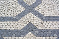Portuguese pavement calcada portuguesa detail of the Royalty Free Stock Photos