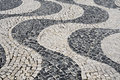 Portuguese pavement typical in lisbon portugal waves patterned Stock Photos