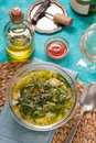 Portuguese soup Caldo Verde on the cyan background vertical