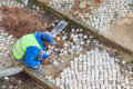 Portuguese worker repairing the sidewalk pavement with the traditional and typical handmade Royalty Free Stock Photo