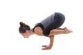 Pose bakasana sporty yoga girl on white background doing handstand or crane Stock Photography