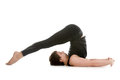 Pose halasana sporty young man working out doing yoga or pilates exercises plow Stock Image