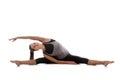 Pose upavishta konasana sporty yoga girl on white background stretching in upright seated angle or balancing bear Stock Photos