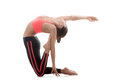 Pose ushtrasana sporty yoga girl stands on her knees on white background while stretching in ustrasana or camel Royalty Free Stock Image