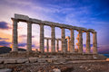 Poseidon`s Temple at Sounion at sunset time Royalty Free Stock Photo