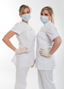 Posing female dentists two young with uniform and mask Royalty Free Stock Images