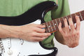 Posing hands of the rock guitarist playing electric guitar Royalty Free Stock Images