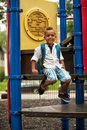 Posing on the playground young mixed race child smiling a school Royalty Free Stock Images