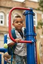 Posing on the playground young mixed race child smiling a school Royalty Free Stock Photography
