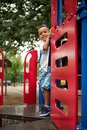 Posing on the playground young mixed race child smiling a school Royalty Free Stock Photo