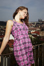 Posing on roof nice lady high top of the building in summer clothes Royalty Free Stock Images