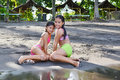 Posing wet two young girls after going out of the water Royalty Free Stock Images