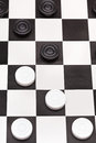 Position on black and white draughts board above view of playing Stock Photography