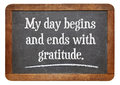 Positive affirmation words my day begins and ends with gratitude on a vintage slate blackboard Stock Photos
