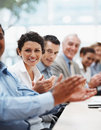 Positive business team applauding at a conference Royalty Free Stock Image