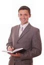 Positive businessman with notepad Royalty Free Stock Photo