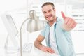 Positive businessman smiling with thumb up Royalty Free Stock Photo