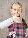 Positive child a girl showing thumb Stock Image