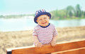 Positive child wearing a hat having fun outdoors Royalty Free Stock Photo