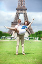 Positive couple having fun near the Eiffel towe Royalty Free Stock Image