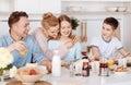 Positive family enjoying breakfast together Royalty Free Stock Photo