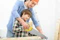 Positive father and son doing renovation Royalty Free Stock Photo