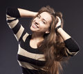 Positive female dark studio background portrait of excited woman long hair brunette Stock Images
