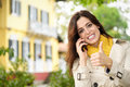Positive female home owner calling by phone in her country house garden confidence woman approving with thumbs up while talking on Stock Photography