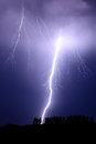 Positive flash lightning strikes from the storm clouds above Stock Photography