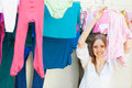 Positive girl drying clothes on clothes line long haired Royalty Free Stock Images