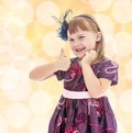 Positive little girl showing thumb up. Royalty Free Stock Photo