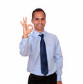 Positive man looking and showing you ok sign portrait of a on isolated background Royalty Free Stock Image