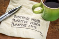 Positive mind vibes and life motivational handwriting on a napkin with a cup of coffee Stock Photography
