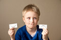 Positive and negative expressions young boy select between Stock Photo