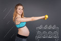 Positive pregnant woman with dumbbels