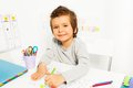 Positive small boy draws with pencil during ABA Royalty Free Stock Photo