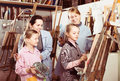 Positive students appraising work of their group mate Royalty Free Stock Photo