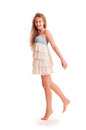 Positive teen girl in dress portrait on white background Stock Images