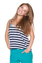 Positive teen girl smiling enjoyment in casual summer clothes with hands in pockets over white background Royalty Free Stock Photo