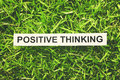 Positive thinking word paper on green grass retro style Royalty Free Stock Photography