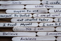 Positive thoughts for self esteem building close up of a hand written message on a popsicle stick as a concept Royalty Free Stock Photos