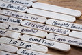 Positive thoughts for self esteem building close up of a hand written message on a popsicle stick as a concept Stock Images