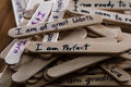 Positive thoughts for self esteem building close up of a hand written message on a popsicle stick as a concept Royalty Free Stock Photography