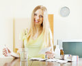 Positive woman with medications at living room Royalty Free Stock Photography