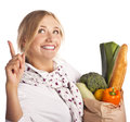 Positive woman with a vegetarian meal. Vegetarians Stock Photography