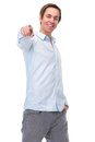 Positive young man pointing finger and smiling Royalty Free Stock Photo