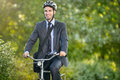 Positive young man riding a bicycle to work Royalty Free Stock Photo