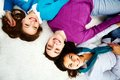 Positivity above angle of three laughing friends looking at camera Royalty Free Stock Photos